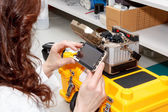 Woman working with fiber optic fusion splicer — Stock Photo