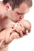 Loving father kissing his baby — Stock Photo