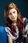 Sitting fashion portrait of young beautiful girl — Stock Photo