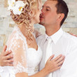 Beautiful young wedding couple kissing — Stock Photo #49053229