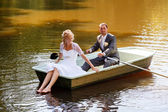 Young just married bride and groom on boat — 图库照片