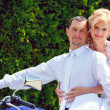 Beautiful young wedding couple on motorcycle — Stock Photo #49187781