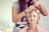 Hair stylist designer making hairstyle for woman — Stock Photo