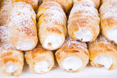 Tube of pastry filled with snow — Stock Photo