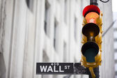 Wall street and red traffic light — Stock Photo
