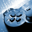 Stock Photo: Game controller toned blue