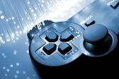 Herní zařízení, tónovaný modrá — Stock fotografie