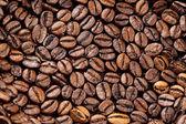 Tło zbliżenie palonych ziaren kawy — Zdjęcie stockowe