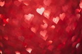 Shiny hearts bokeh light Valentine's day background — Stock Photo