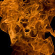 Stock Photo: Fire and flames on a black background
