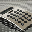 Silver calculator on the grid — Stock Photo