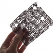 Stock Photo: Holds in hand circuit board on white background