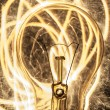 Bulb and sparklers   on black background — Stockfoto