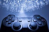 Controlador de juegos y luz azul — Foto de Stock