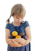 Girl with plums on the white background — Stock Photo