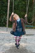 Pupil in school uniform on a swing — Stock Photo