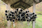 Pipes under the wooden roof — Stock Photo