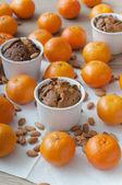 Christmas cupcakes and mandarins — Stock Photo