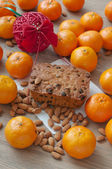 Christmas cake and mandarins — Stock Photo