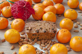 Christmas cake with mandarins, almonds — Stock Photo
