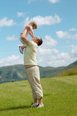 Father and child on a hill — Stock Photo