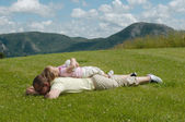 Father and child on the grass — Stock Photo