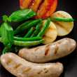 Sausages and fried tomatoes. — Stockfoto