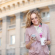 Beautiful woman holding a cup of coffee — Stock Photo #41226661