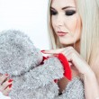 Blonde with a teddy bear  — Stock Photo