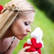 Blonde girl kissing a toy — Stock Photo #14938627
