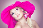 Portraite of a blonde girl with a hat — Stock Photo
