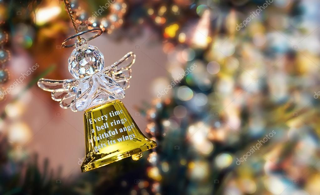 Golen Angel Bell on a Christmas Tree  Stock Photo #16933409