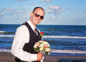 Groom with a Bridal Bouquet — Stock Photo