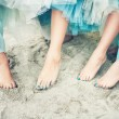 Stock Photo: Feet in the sand