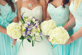 Bride and Bridesmaids bouquets — Stock Photo