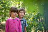 Boy and girl in park — Foto Stock
