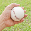 Man hand hold white baseball — Stock Photo