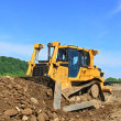 The bulldozer on a building site - Stock Photo