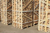 Chipped fire wood in packing on pallets — Foto Stock