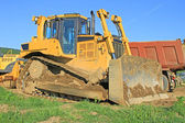The bulldozer on a building site — Stock Photo
