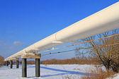 The high pressure pipeline in a winter landscape — Stock Photo