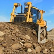 The bulldozer on a building site — Stock Photo #20981227