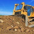 The bulldozer on a building site — Stock Photo #21922757