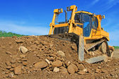 The bulldozer on a building site — Foto Stock