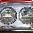 The two front headlights of classic old car close-up. — Stockfoto
