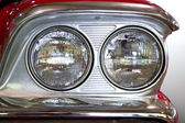 The two front headlights of classic old car close-up. — Stock Photo