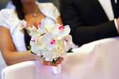 Bride with white orchids bouquet — Stock Photo