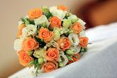 Wedding rose bouquet on kneeler — Stock Photo