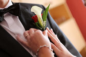 Pinning a boutonniere — Stock Photo
