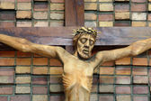 Wooden figure of Jesus crucified, in the church during Easter — Stock Photo